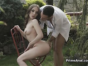 eating out girlfriends bum in the garden