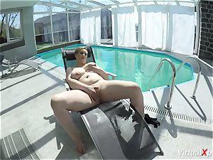 hefty knocker cougar stroking at the pool