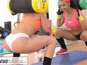 FitnessRooms 2 girl-on-girl gym buddies having a exercise
