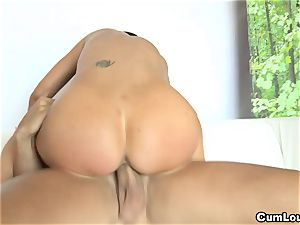 big-chested Jasmine Jae riding a yam-sized spear with her cupcakes out