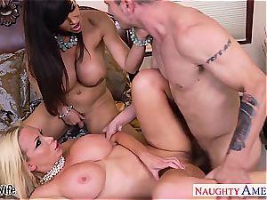 Nikki Benz shares a large cock with super-cute Lisa Ann