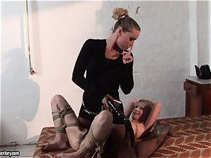 Kathia Nobili putting some clip in torrid babe's bosoms