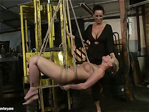 Kathia Nobili and Mandy Bright figure trussing with string