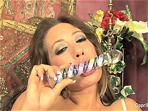 Capri Cavanni gets herself off with a glass fake penis